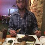 Hubby and his deliciously HUGE ribeye!