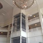 Lobby with chandelier and vintage elevator