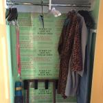 Closet with funky bathrobes and yoga mat!
