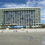 View of hotel from beach at low tide