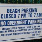 Sign over another parking space.