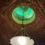The bathroom ceiling and light fixture