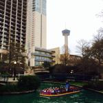 View of Riverwalk with Grand Hyatt hotel and Tower of the Americas in background.