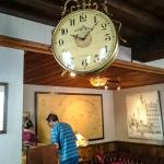 The large spinning clock in the dining room