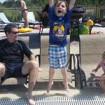 My son so excited to go swimming. Family lounging by the pool