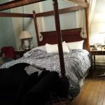 Comfortable four-poster king bed