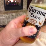 "Enjoying a beer from their small bar in front of the warm fireplace.  Was thinking, ""Why did I r"