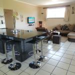 IMBONISO 8 Sleeper Unit's fully equipped Kitchen and Comfortable Lounge area with DSTV and Airco