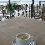 I always stay at the terrace to get a sight of the sea. It's lovely. Hey, the coffee is free!