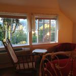 Our room including rocking chair and hasket