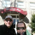 My husband & I in front of the Windsor Inn