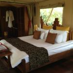 Luxurious bedroom; they place hot water bottle under the sheets to keep you warm at night