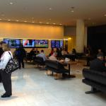 Lobby area with tbs, seating and lots of outlets