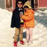 Kids in front of hotel.