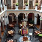 courtyard interior of hotel, restaurant below