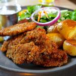 Wonderful panfried oysters, roast potatoes, and salad