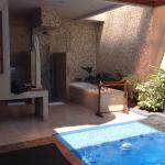 Shows  pool and open air bathroom