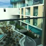 View from balcony of outdoor common area and pool