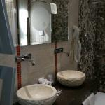 Double sinks in suite with canal view