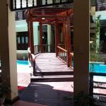 the bridge over the swimming pool leading the second section of the hotel