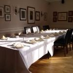 old fashioned napery and cutlery laid up for a function