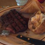12 oz sirloin cooked to a perfect medium rare with baked potato and Texas toast!