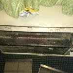 Messed up a.c. unit with dirty filters, un-finished patched wall, pubic hair on bed from previou