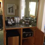 Room with fridge and coffeemaker