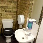 Toilets with nice exposed brick