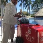 Fredy the bartender with ice cream bars poolside