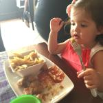 my little girl tucking in to the freshly made chicken nuggets and chips