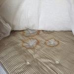 Lifting up the mattress protector to find even worse staining