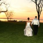 Bride and Groom walking towards the bluff during sunset