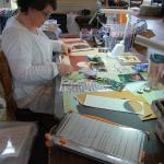 CHAOS member compiling her scrapbook in our Conservatory.