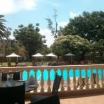 view of pool from outdoor dining area.