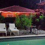 NIght shot across pool to bungalow