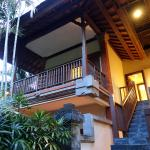 Upstairs room -  Deluxe Chalet. Balcony facing tropical trees.