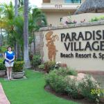 By the main gate to Paradise Village