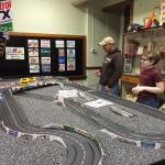 Dad and son enjoying the slot cars.