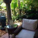 Comfortable chair in the shade on a villa patio. Paradise!