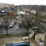 View from 4th floor, end of hallway. In April the pool in foreground is covered with a tarp. My