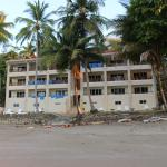 not the prettiest concrete slab of a hotel on the beach….