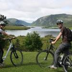 Cyclists enjoying the view over Lough Veagh Gleneveagh National Park County Donegal Ireland