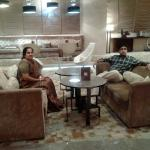 Vignesh and Latha relaxing in the lounge of Hilton