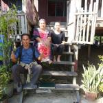Our homestay hosts in front of the house