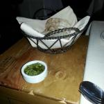 Rustic Bread with Pesto Schmere (on the butcher block table next to our table added for more roo