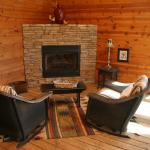 Screened-in area with gas fireplace. Porches were HUGE!