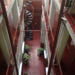 View from 3rd floor overlooking ground floor and spiral staircase (alternate stairs available) t