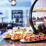 The exclusive Club Lounge features complimentary food and beverage presentations throughout the