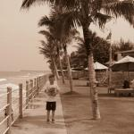 My son on the sea front of the hotel gardens